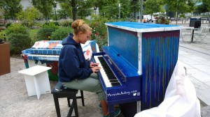 092613-girl-plays-street-piano
