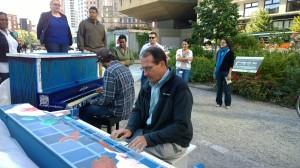 Economist-plays-street-piano