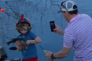 042116-boy-catches-fish-Sudbury-River
