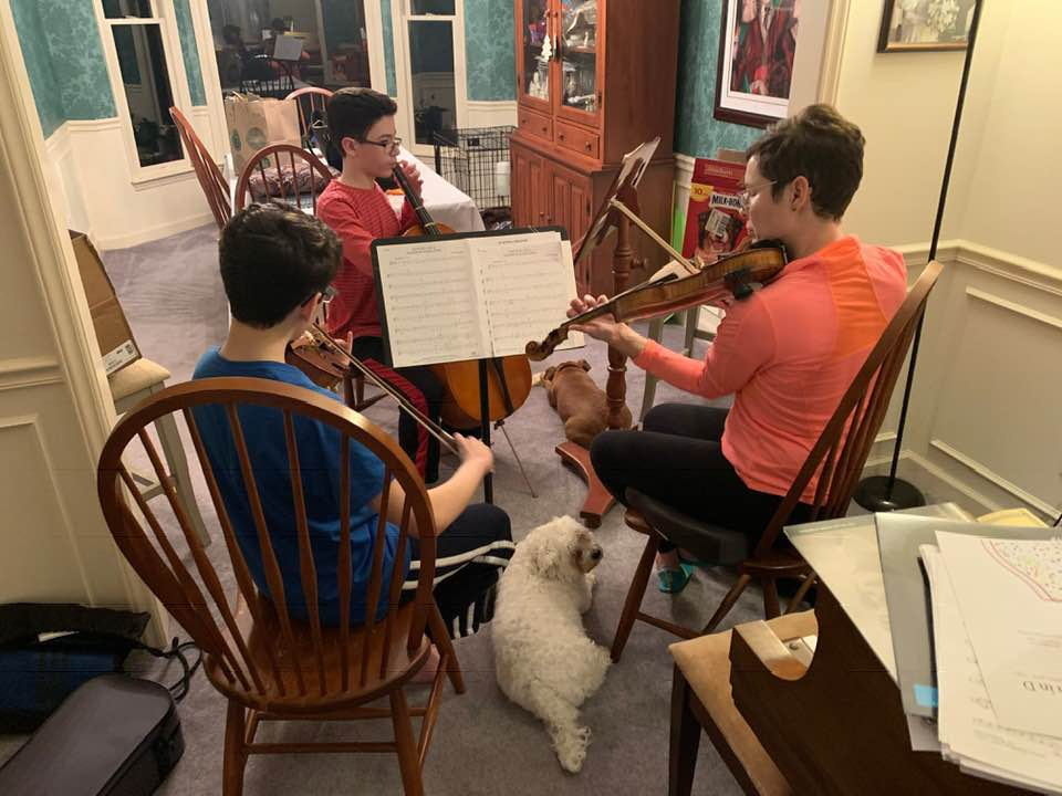 021719-mother-and-sons-and-dog-enjoy-music
