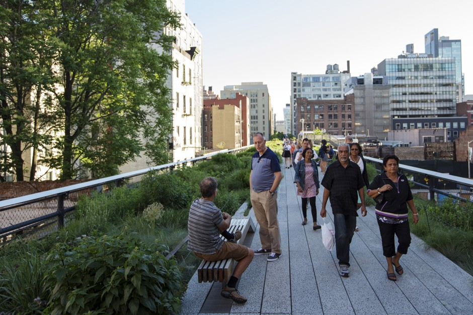 Pedestrians take advantage of some sunshine to walk down the High Line park in New York