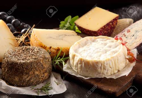 Delicious array of gourmet cheese on a platter
